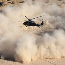Helicopter landing on a desert