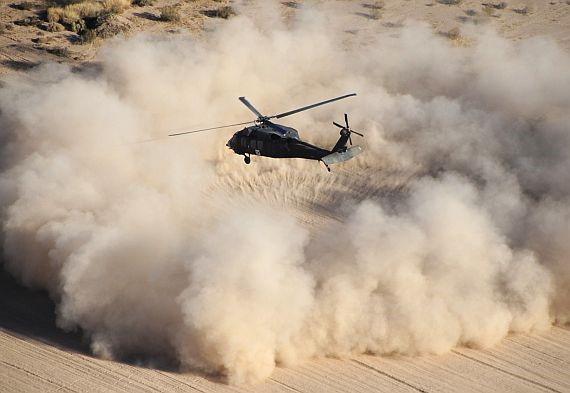 Helicopter landing on a desert