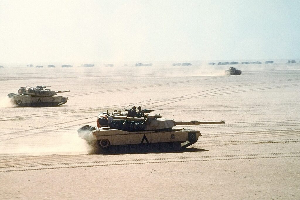 Two M1 Abrams tanks on a mission in Operation Desert Storm