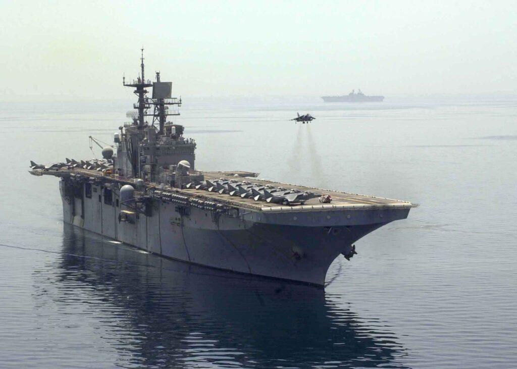 A USMC Harrier above the deck of the USS Bataan